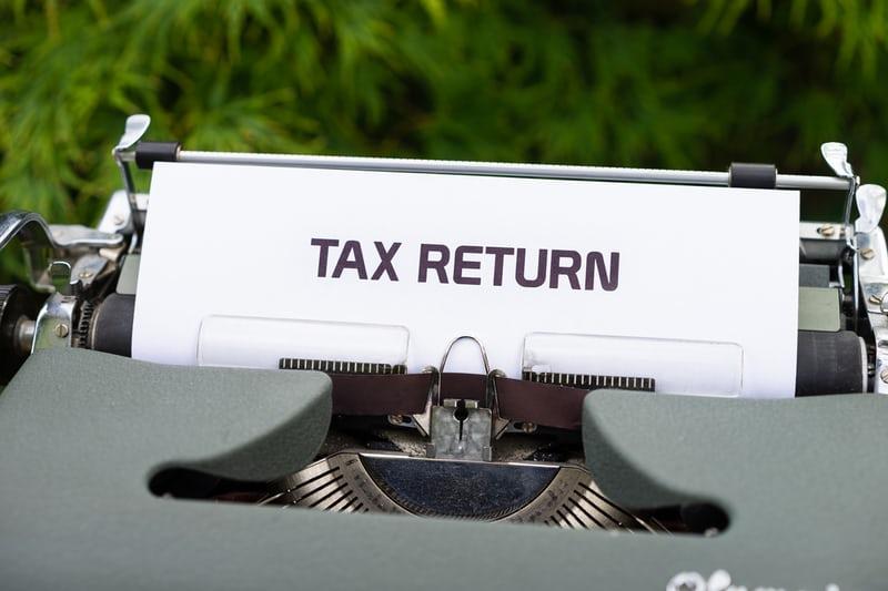Icelandic tax return written on a white sign