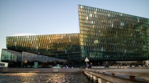 Harpa concert hall in Reykjavik with the sun reflecting off of the glass windows