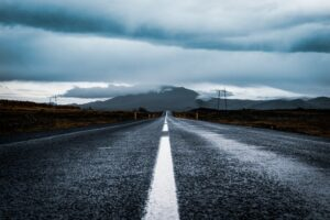 A dark tarmac road up close along Iceland's route one