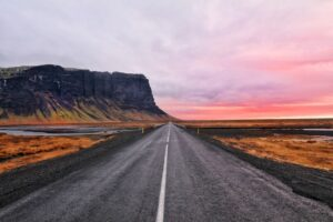 The ring road on Iceland's South Coast under a pink sky