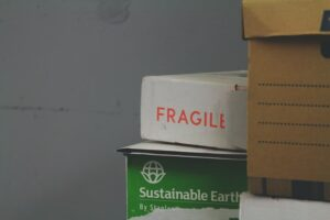 A stack of boxes with fragile written on one