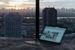 Work remotely from an apartment room in a city skyscraper
