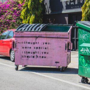 A large purple bin with writing on