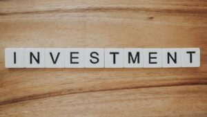 Investment spelt with scrabble pieces