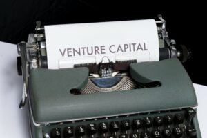 A typewriter with venture capital written on the paper