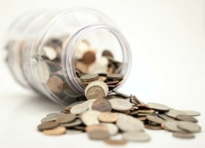 A jar of spilled over change symbolising pensions in Iceland