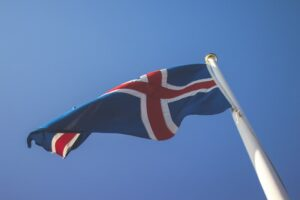 The Icelandic flag blowing in the wind under a blue sky