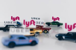 Small model toy uber cars showing the rise of the gig economy