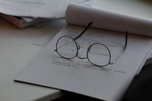 A pair of glasses resting on a notebook