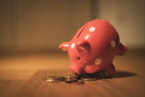 A piggy bank with some loose change