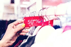 A tax discount symbolised with a retail shop sale item offer