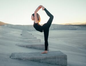 A ballerina stretching with her leg over her head in Iceland symbolising flexible working