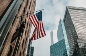 A US flag flying on Wall Street, New York