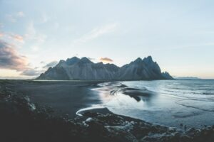 Vestrahorn mountain in Iceland under a blue sky available to remote workers