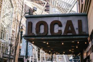 A city with a sign saying local
