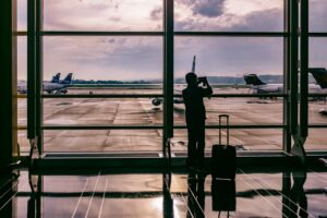 A silhouette of a person waiting at an airport