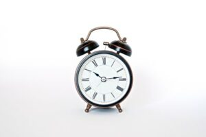Keeping track of remote workers time and work allocation symbolised with an alarm clock