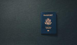 A blue passport on a black background