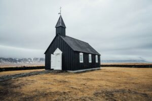 Budir black church in Iceland's Snaefellsnes peninsula with overcast skies above