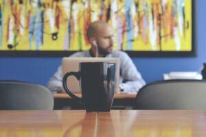 A remote worker enjoying a coffee