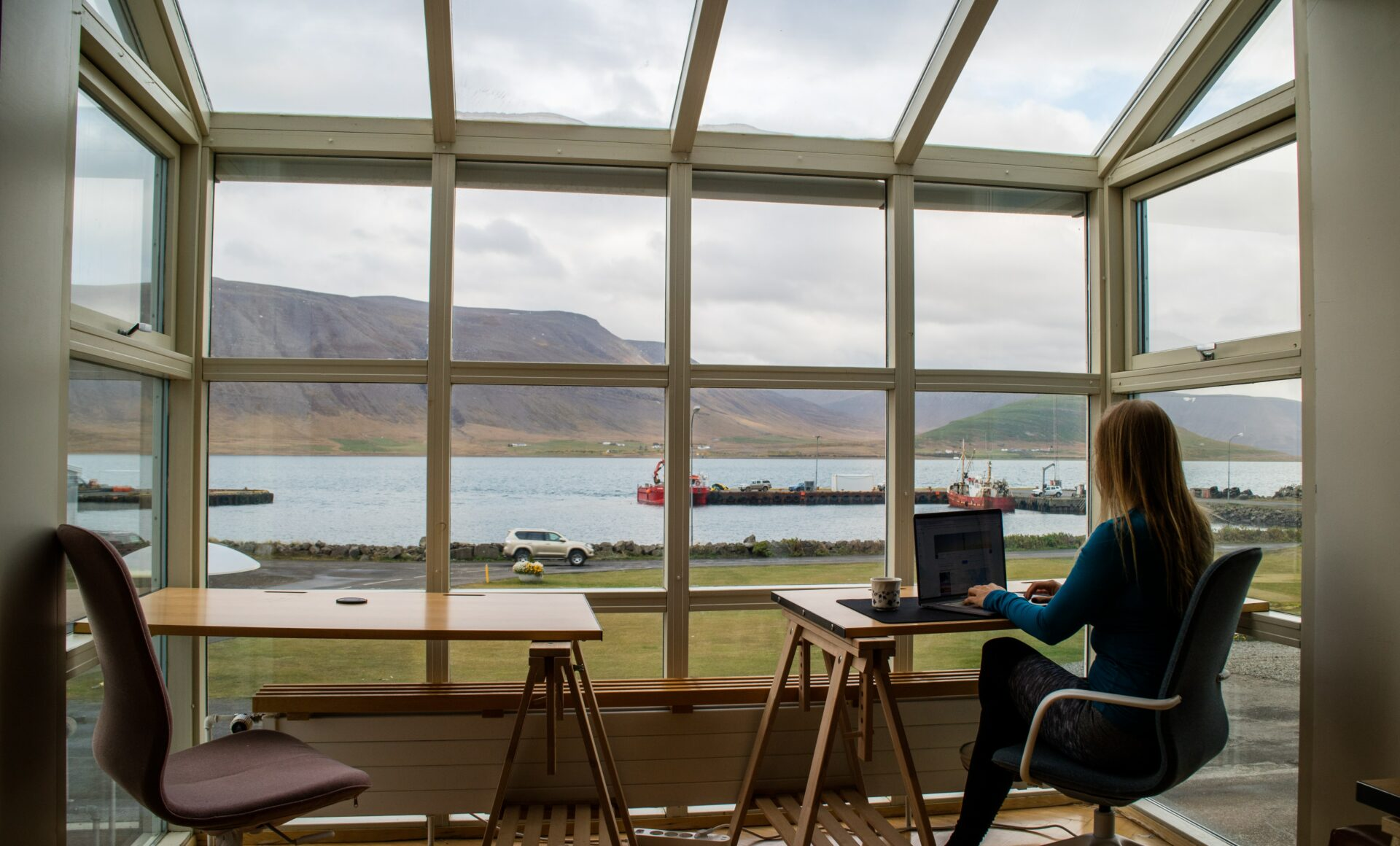 A person working remotely with a view of fjords in Iceland